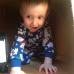 Boy inside repurposed box