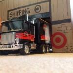 toy truck outside cardboard box