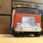 toy truck outside of box